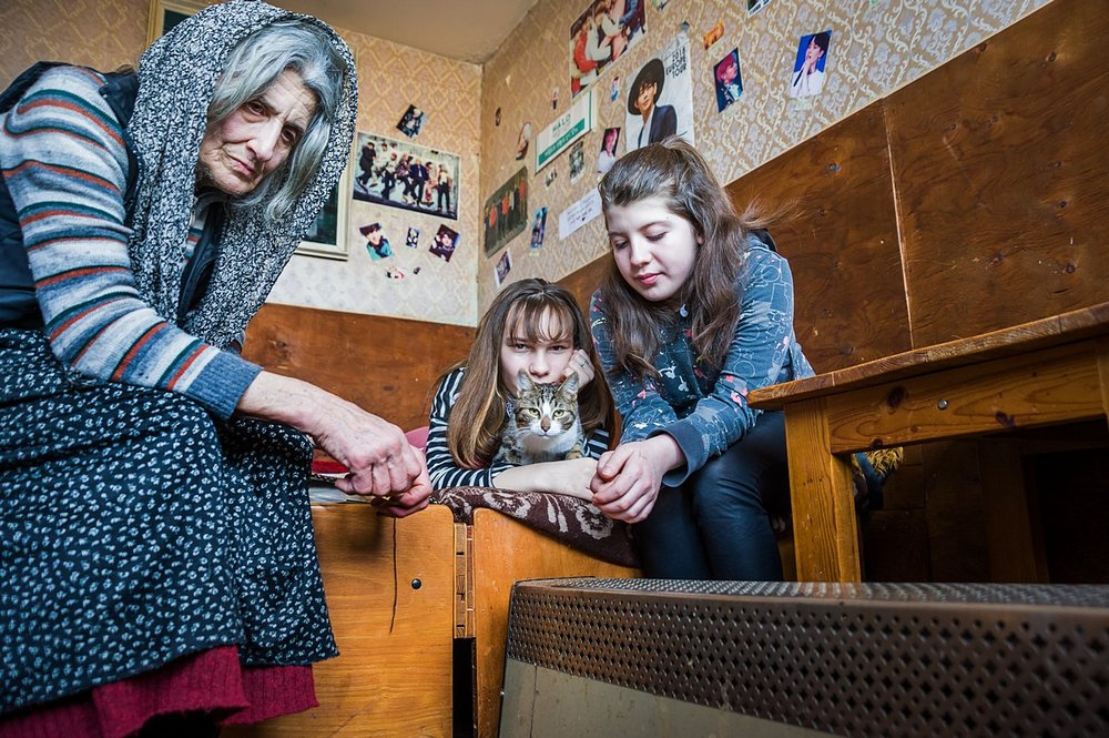 SOFIA • Liliya (71) takes care of Atanasiya and Dimana (both 14); all three live in one room during winter, with only an electric heater.