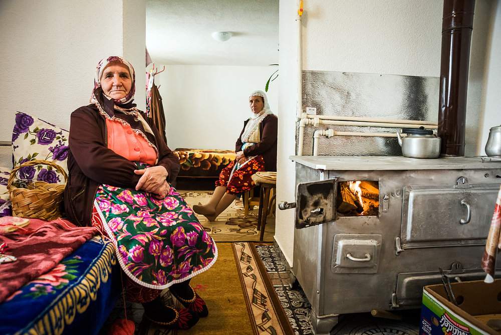 RIBNOVO • Nefie (69, left) uses a 50-year-old wood stove for heating and cooking; pipes connected to it deliver hot water to the bathroom.