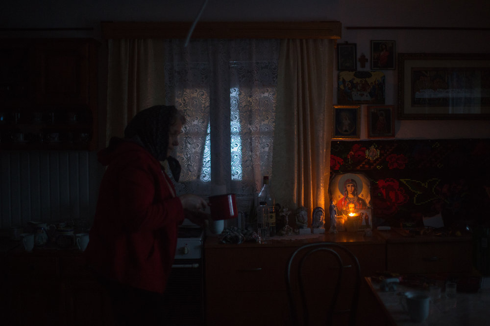 MOLODVITA •  Without a grid connection, Victoria and Vasile Procopiuc still use oil lamps; batteries for electric lamps, they say, would cost almost half their income.