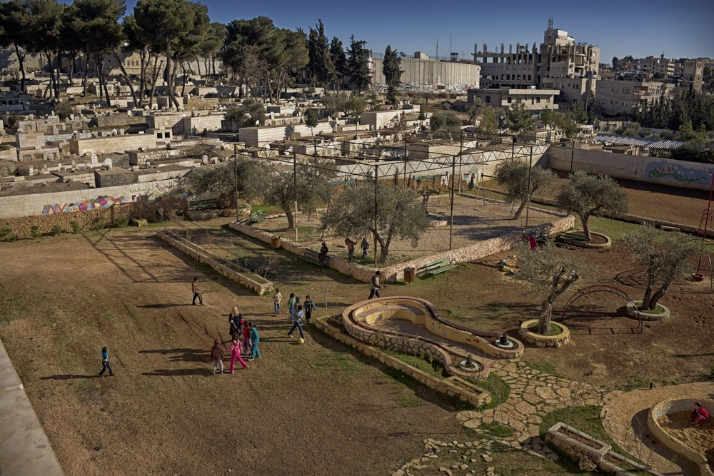 Spelende kinderen in Aida vluchtelingenkamp