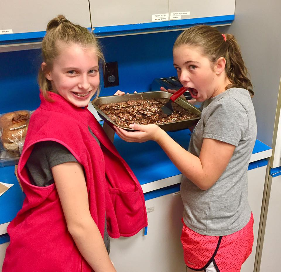 Youth help making brownies for the women!