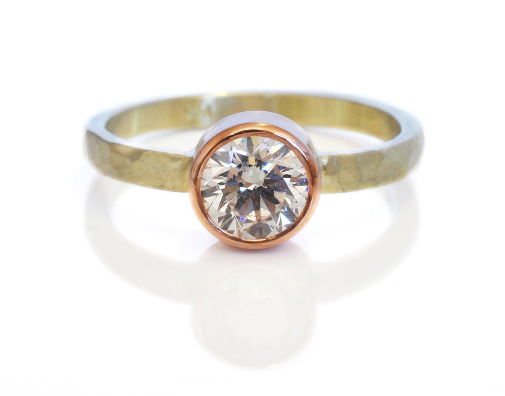 david-Sarah-side-whiteRoundBrilliantDiamond-hammered14kgreengold-14kredrosegoldbezel-alternative-engagementRing.jpg