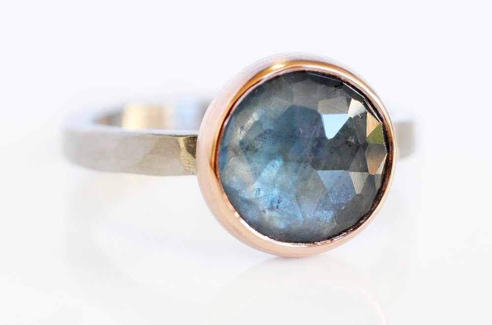 Katie picked out this TO-DIE-FOR rose cut blue sapphire ring.  The clear ocean blue sapphire is set in a 14k red gold bezel on a hammered 950 palladium band.