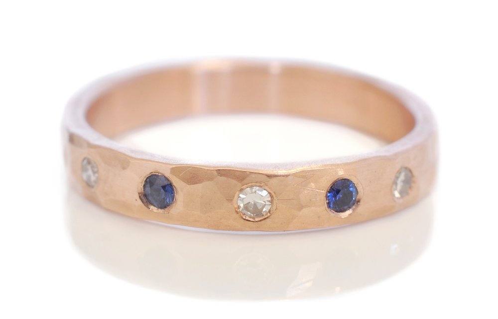 JacobB-3mm-half-eternity-band-hammered-14k-redrosepink-gold-flush-set-diamonds-sapphires-alternative-wedding-band.jpg