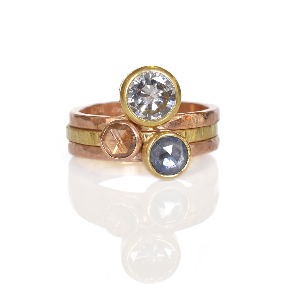 This A-mazing stack was originally just the top two rings and I didn't think it could get any better.  But the addition of the corn flower blue sapphire transformed this stack into rich mix of colors and textures.