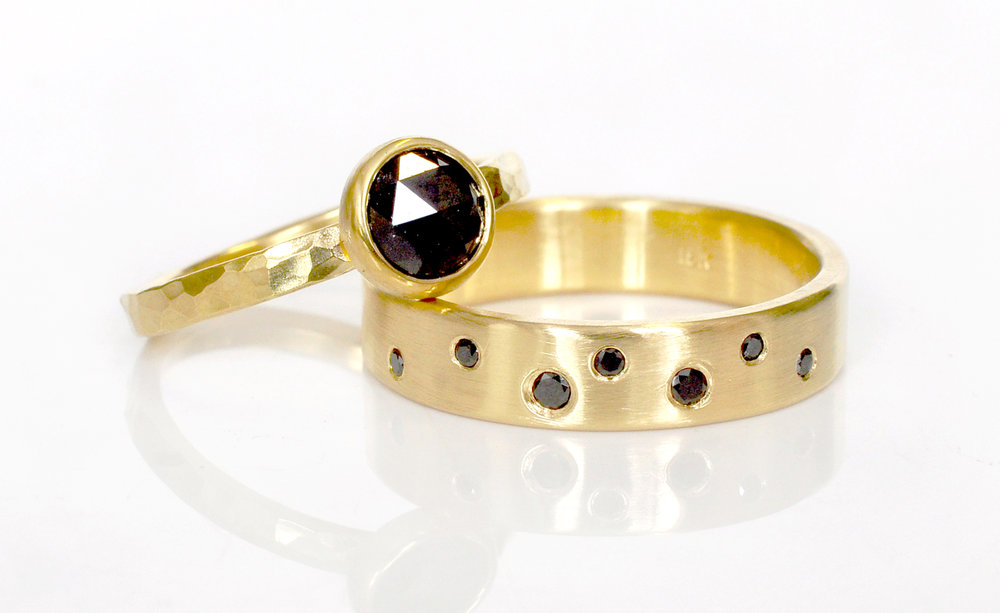 1fba608562b ... set of co-ordinating wedding rings. Creal chose a black rose cut diamond  in hammered 18k yellow gold. Matched with a satin finish band of flush-set  ...