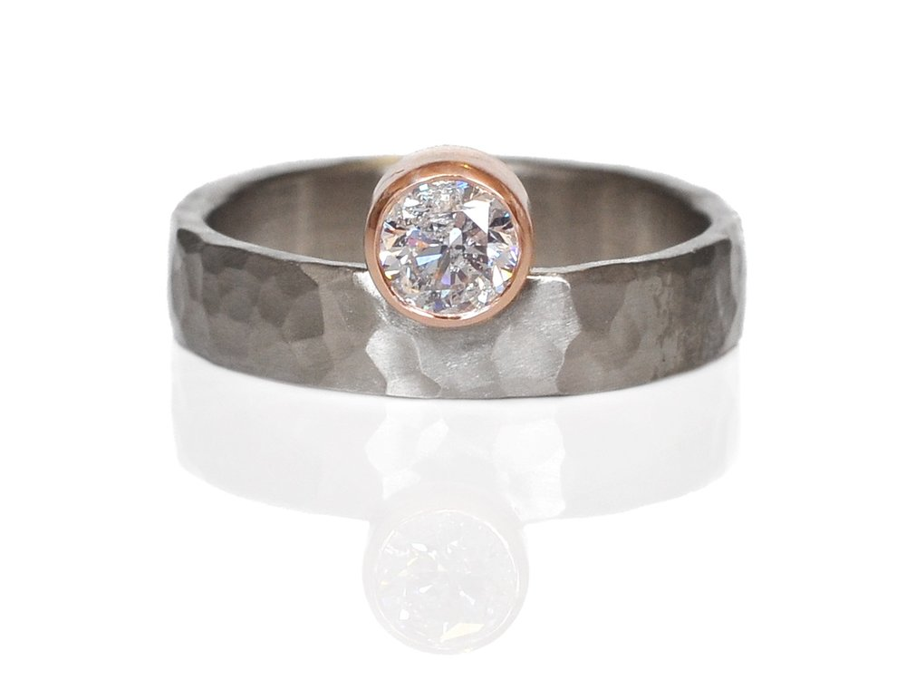 Such a gorgeous custom remount in hammered palladium with an off-set 14k red gold bezel.