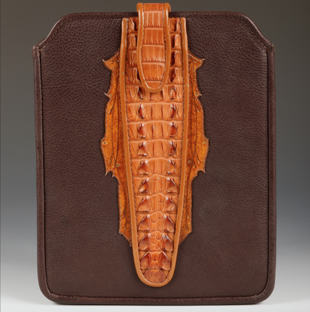 David Switzer - http://www.harvestleather.comDesigned and crafted using traditional tooling techniques or exotic inlays with a southwestern flair