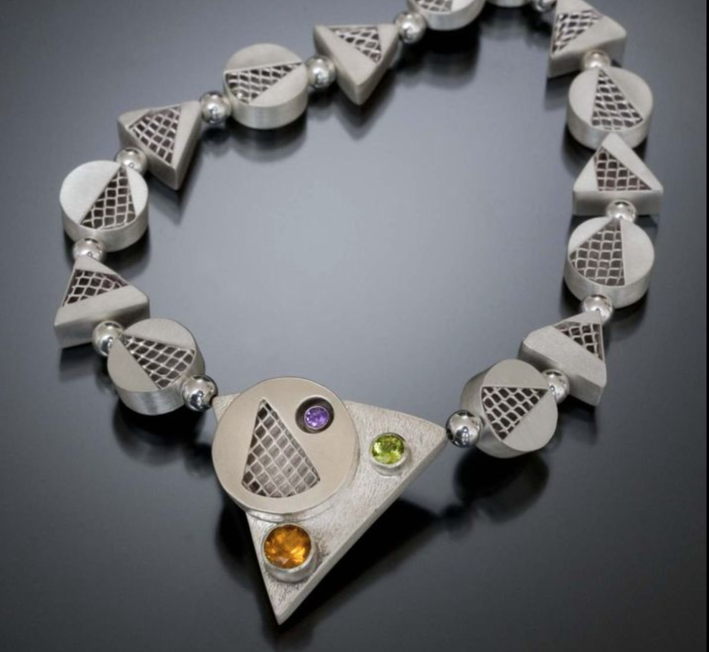 PAZ - Argentium silver jewelry w/precious stones and exotic wood. Fused,soldered,hinged,riveted,stitched,reticulated,textured,deconstructed,overly,inlay,stamped,granulated to produce one of a kind jewelry.