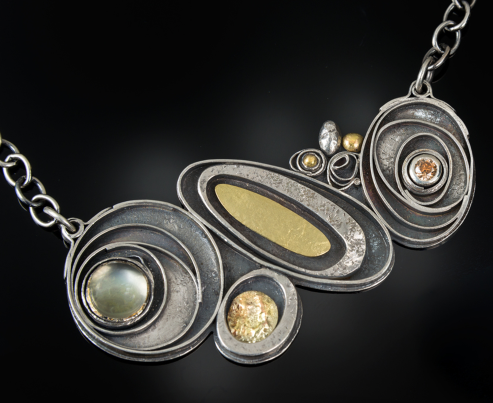 Elizabeth Hake - http://wearjewelry.netHandmade Sterling Silver Jewelry of sheet metal and wire. hand cut, roller printed or hammer textured, fused, soldered, and patinated.. Accented with faceted stones and solid gold elements