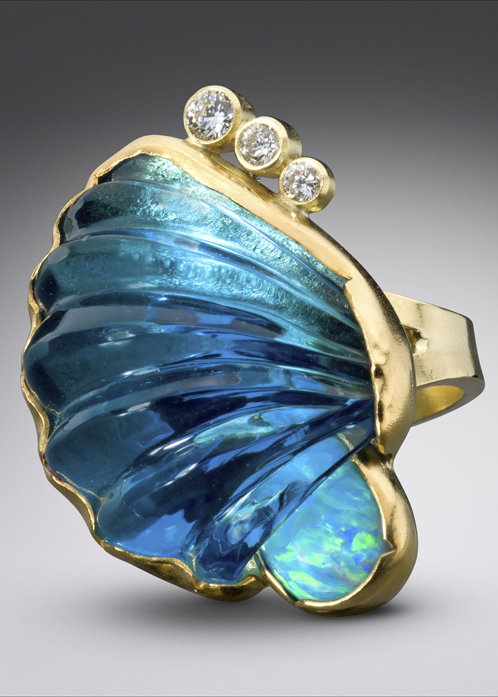 Don McCoy - http://www.donmccoyjewelry.comGem Cutter and Metalsmith, I hand fabricate settings from recycled silver and gold for the gemstones I carve and inlay.