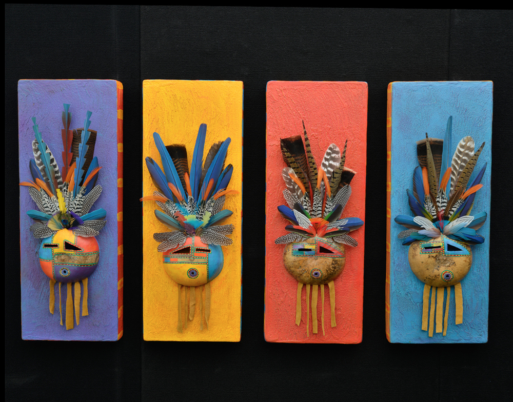 Douglas Fountain - http://www.dougfountain.comFeathers masks with exotic fallen feathers on venetian plaster and totems.