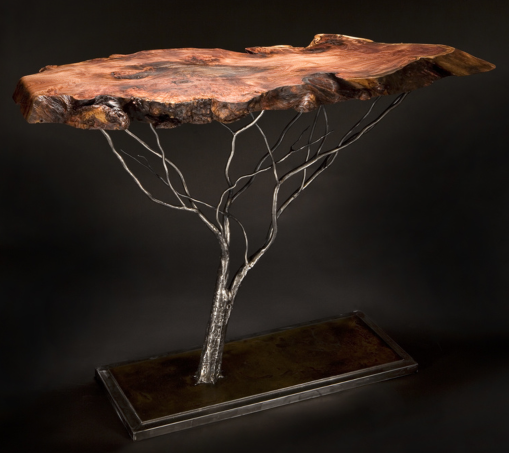 Gary Moser - http://www.theweldeddonkey.comUnique handcrafted tables with rescued live edge tops with hand rubbed oil finish. They are resting on handcrafted metal trees. White aspens are hot patinas. All with 4 coat lacquer finish