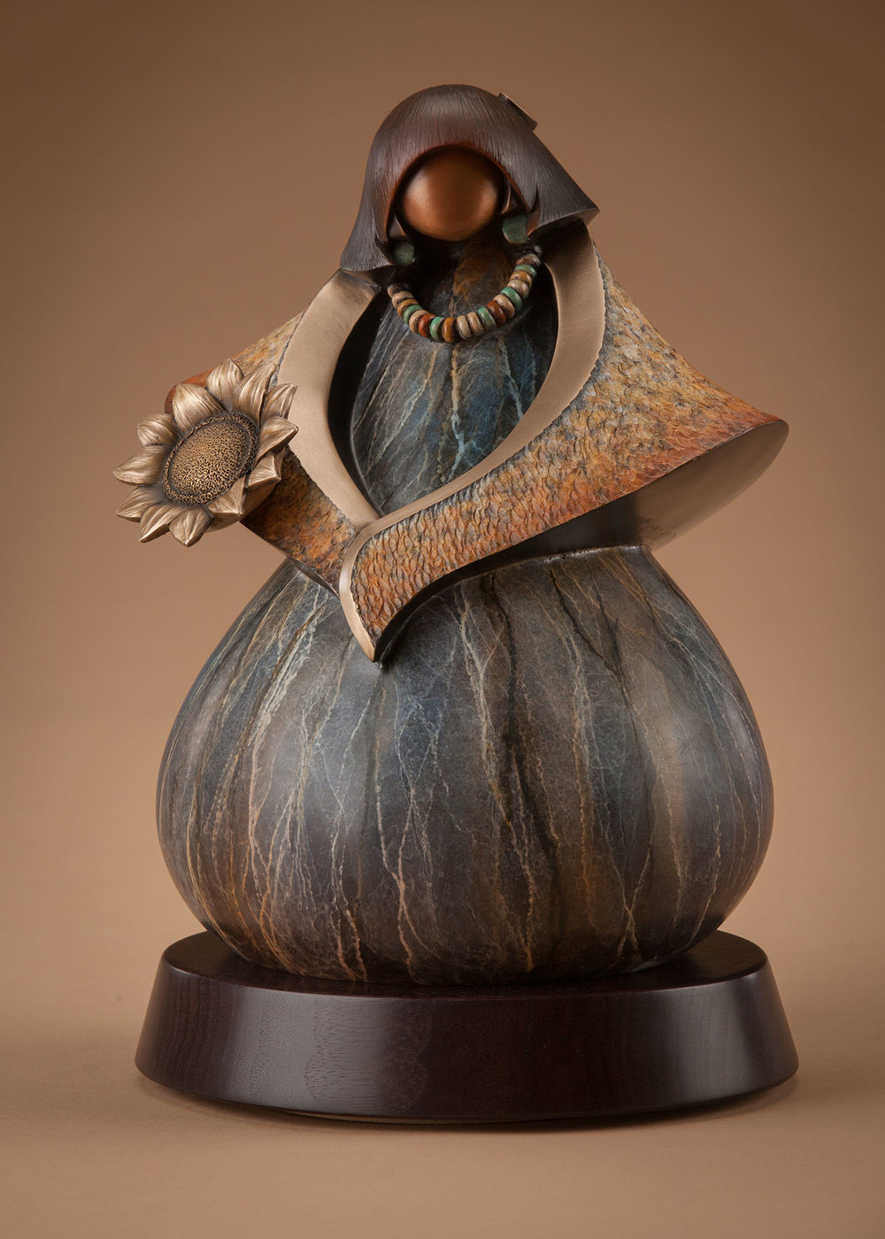 Kim Obrzut - http://www.kimobrzut.comKim starts with clay as her voice with Native symbolism and cast into bronze using the lost wax process. Her patinas are done with different chemical combinations and techniques along with high polish