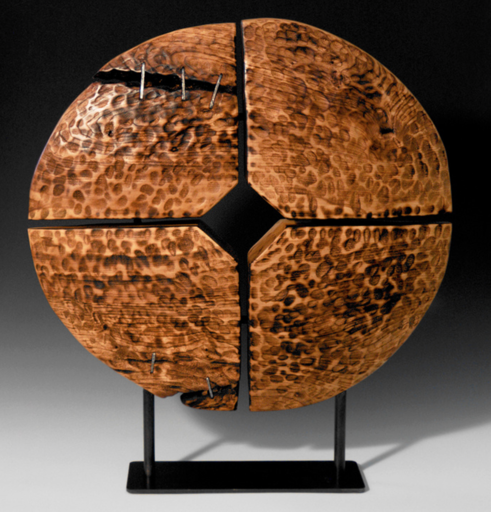 Jay McDougall - http://www.jaymcdougall.comFree-hand carved from single blocks of green wood. My process does not involve any glue-ups, joinery, or lathe-work. I work alone, from gathering my logs through the final coat of hand-rubbed wax.