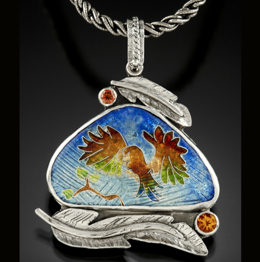 Roberta Starbird - http://www.starbirdjewelry.comWe use the ancient technique of cloisonné enamel, firing 10 or so layers of powdered glass onto silver, to create colorful components. We set these in sterling silver and embellish with gold and gems.