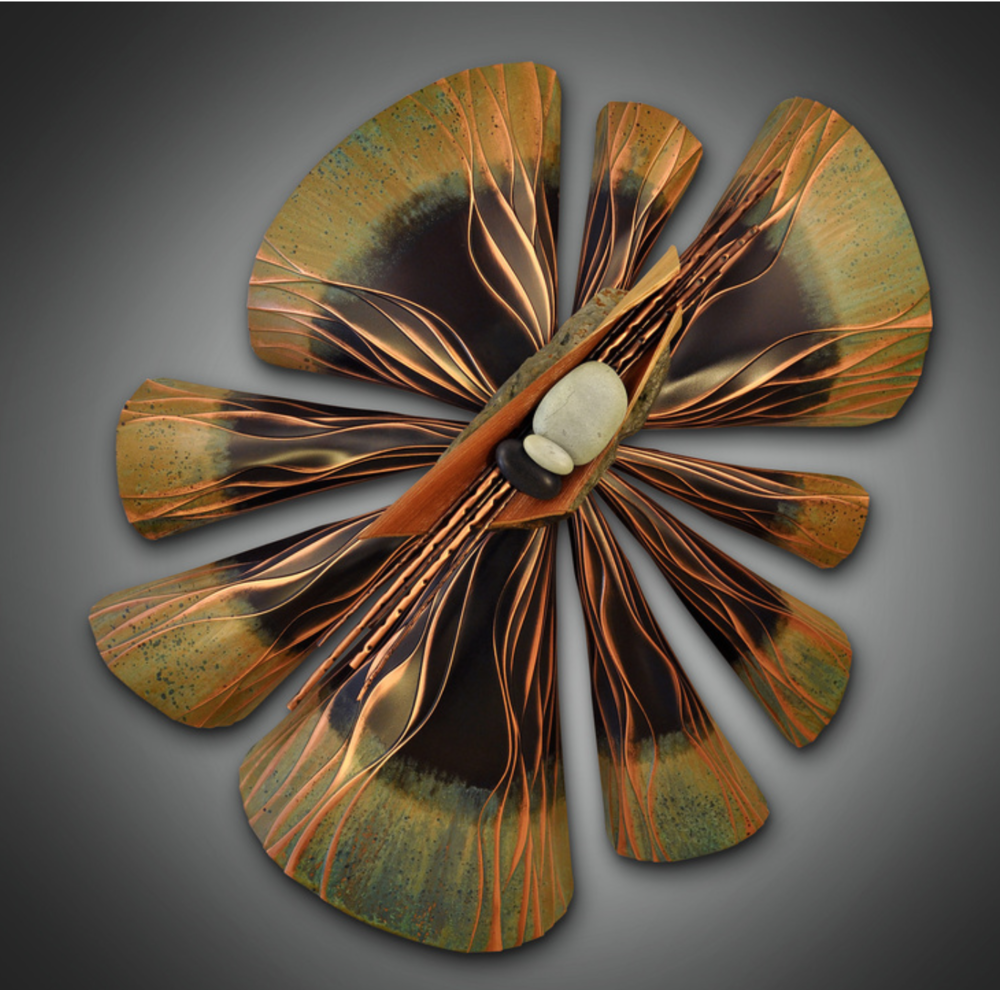 Kurt Ruby - http://www.kurtruby.comHand formed copper wall sculpture using wood, stone and other organic materials. as a third generation metal smith, i use my Grandfathers' hand tools to create dimensional and focal sculptures.