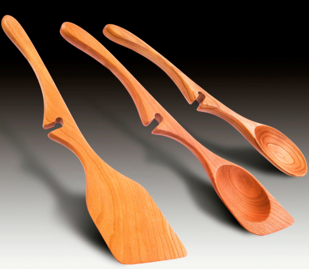 Richard McCollum - http://www.spootch.comCherry wood Spoon designs that are free form cut on a band saw, drilled and drum sanded. They are formed using a drill press and a ball sander to shape it then hand sanded Bee's wax and oil finish