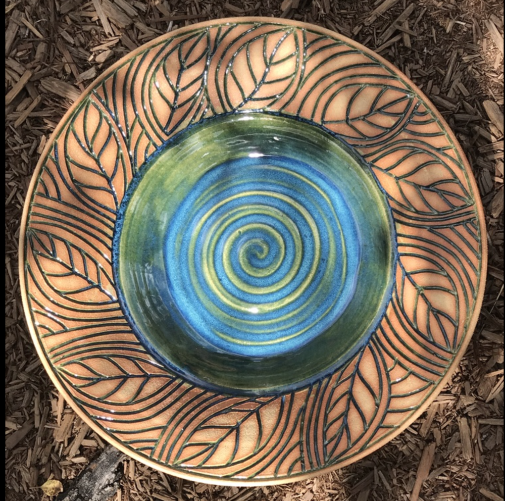 Anastasia Bliss - I individually wheel-throw and hand-carve each piece.I then fire and glaze each piece, and wipe away excess glaze, using a sgraffito-like technique,leaving the beautiful clay-body partially exposed.