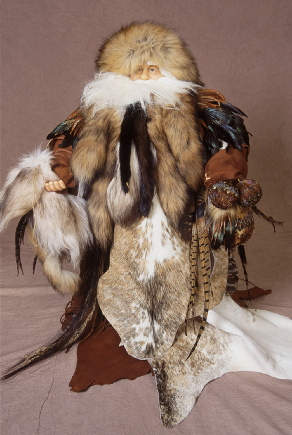 Anita Baptiste - Fiber mixture from animal skin & bird feathers. Final details consist of other animal skins & beads.