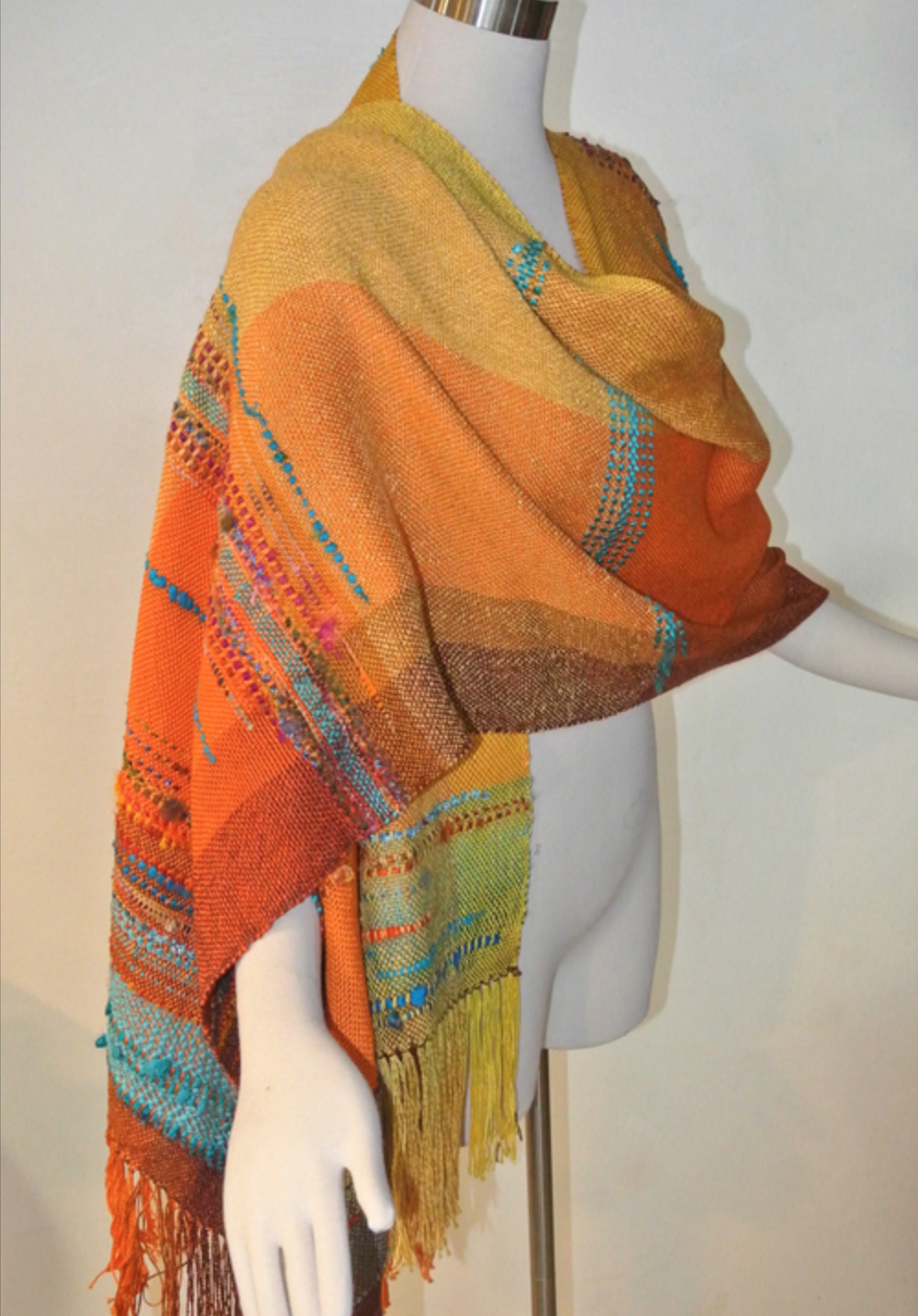 Sherry Kromka - http://Etsy.com-handwovens by sherry kI weave high quality yarns, including chenille and bamboo, on a floor loom, creating unique designs with bold, exciting colors. I weave ponchos, wraps, shawls and ruanas, which I call