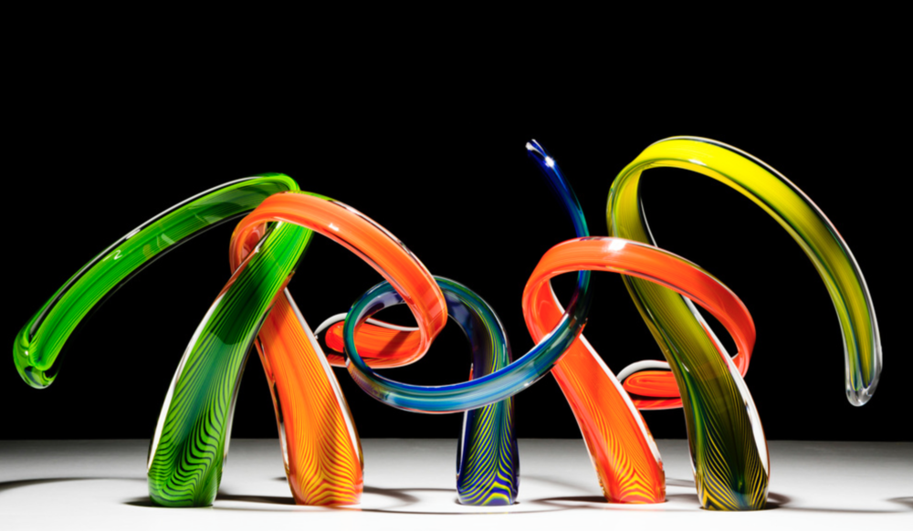Scott Hartley - http://www.infinityartglass.comHand-sculpted molten glass manipulated using Venetian techniques, brute strength & scientific precision to create fine art glass sculptures. Each individual piece is perfectly balanced & intertwined.