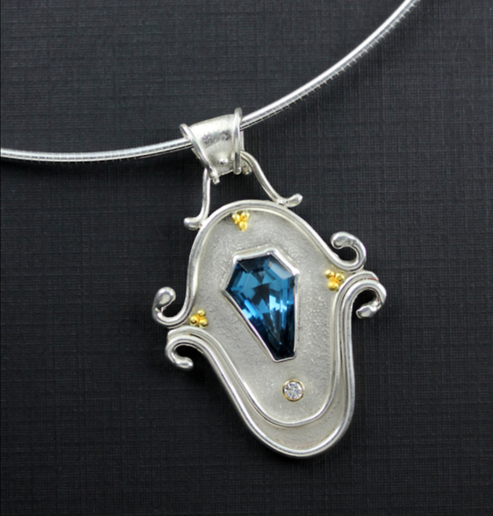 Janet Alexander - http://janetalexander.netI hand-fabricate my jewelry pieces using silver and gold. I use metalsmithing techniques; rolling mill for texture, sawing,soldering,and hammering to create unique one-of-a-kind work of wearable art.