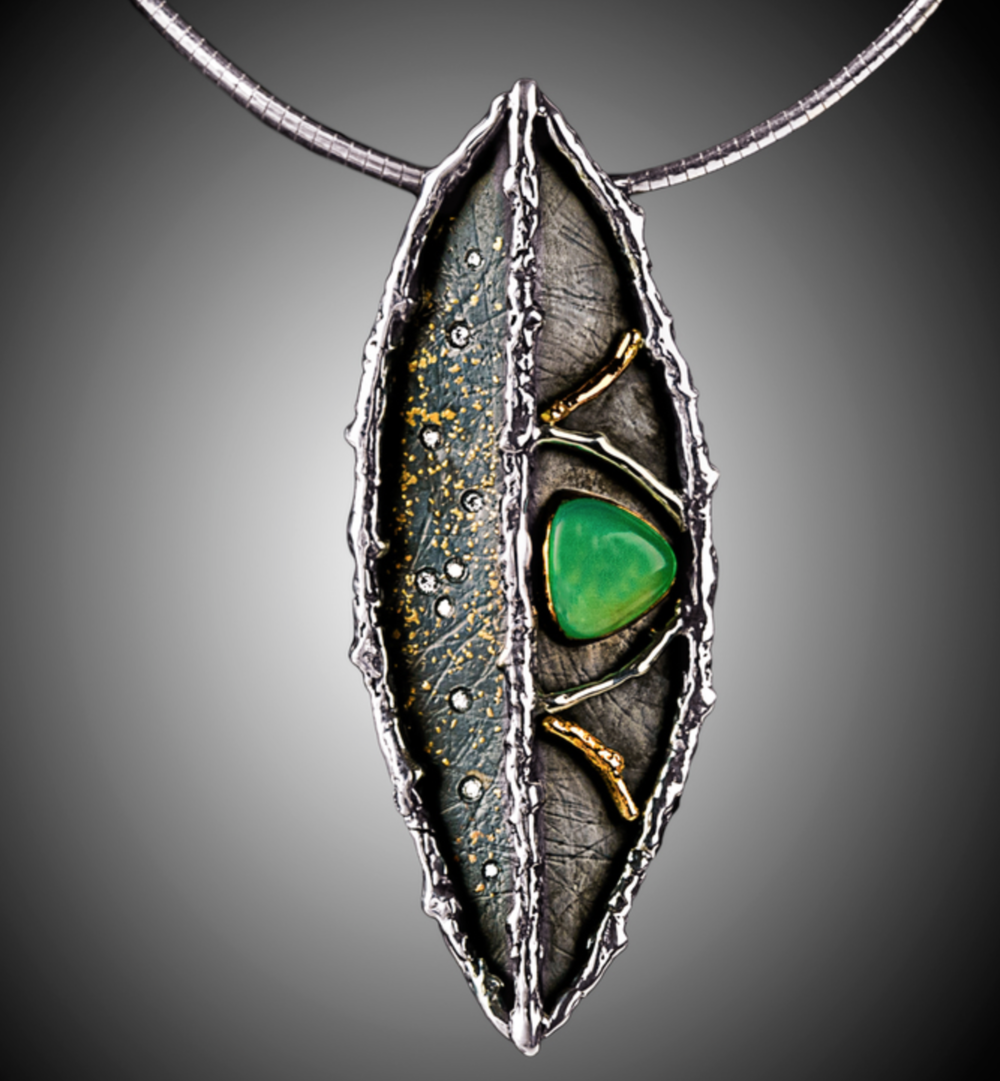 Michelene Berkey - http://tigressdesignstudio.comSterling & high karat gold jewelry with elements of cast Bristlecone Pine and Cottonwood twigs. Roller printed, forged, oxidized & fabricated with unusual gemstones and Freshwater pearls
