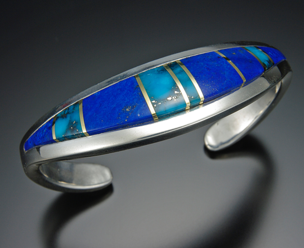 Betsy Bracken - Gemcutting is my forte, in my colorful inlaid gemstone jewelry. The metalwork that frames each piece, is either cast from my original waxes, or fabricated from sheet and wires in gold and silver.