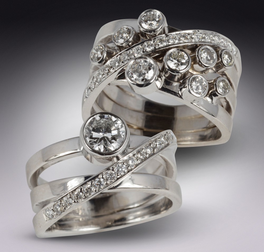 Mark Grosser - http://mgrosser.comI create bold, dramatic designs featuring yellow, white & red gold, diamonds & gemstones. I use lost-wax techniques enhanced with hand fabrication to create a fusion of the natural and architectural.