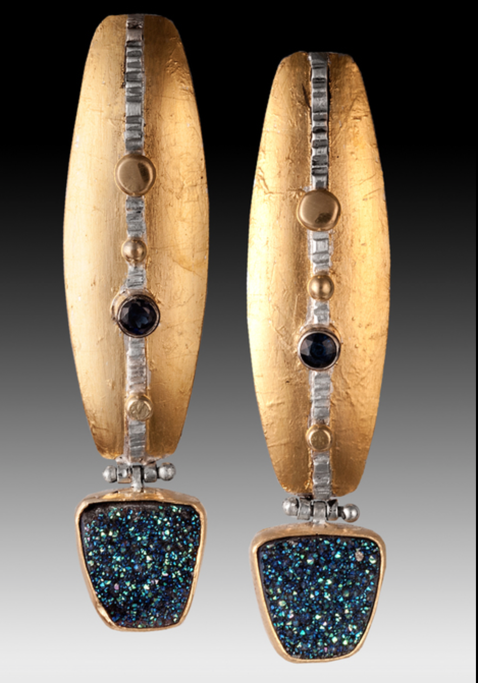 Sandy Harris Murphy - http://www.sandyharrismurphy.comConsciously sourced diamonds,precious and semi- stones are incorporated in fabricated designs.Keumboo,22K and 14K gold refined in the Colorado studio ('green' metal) in hand fabricated designs.
