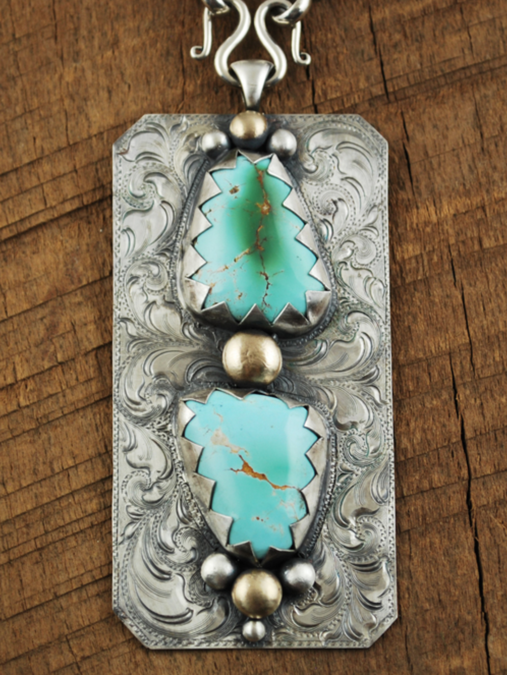 Ivy McNulty - http://www.imsilver.comHand engraved jewelry crafted of silver, copper & bronze create original designs. Adornments of turquoise, elk ivory & horsehair complete these necklaces, pendants, earrings, bracelets & more.
