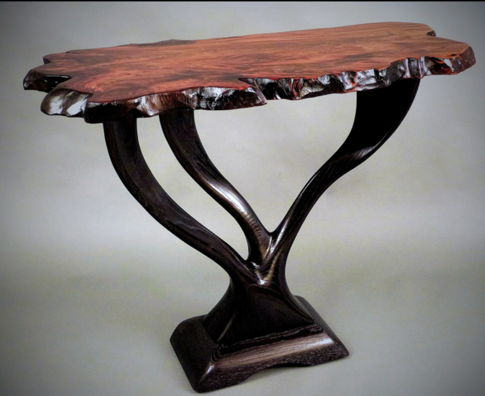 Bill & Toni Palmer - http://www.billandtonipalmer.comArt furniture and wall sculptures, all heavily influenced by nature, carved from exotic hardwoods and live-edge slabs, with fired- glass accents.