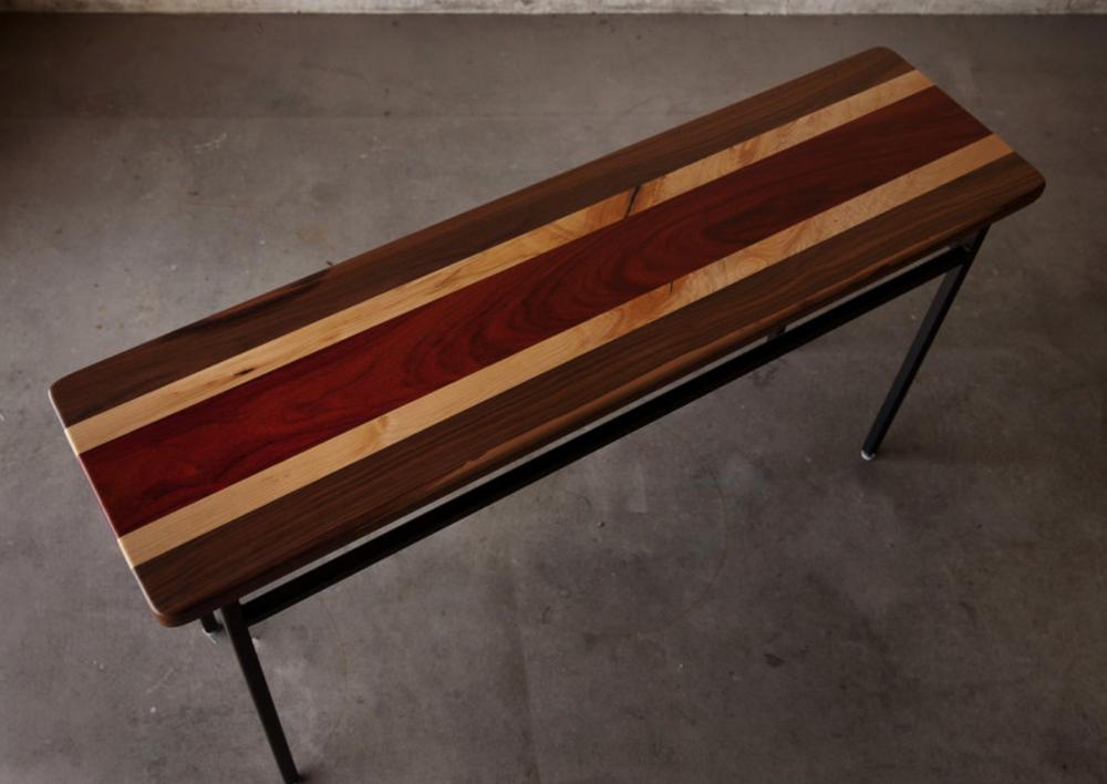 Adrian Vogel - http://www.hardwoodreclamation.comI utilize wood and steel to create functional art.
