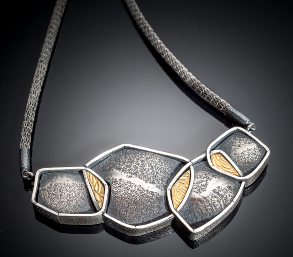Michele Black - http://www.esotericafinejewelry.comMy secret desire is to challenge the conventions of fine jewelry.A mobile studio gives me the freedom to engineer and create wearable sculptures.Made with my own mill-textured silver,gold and gems.