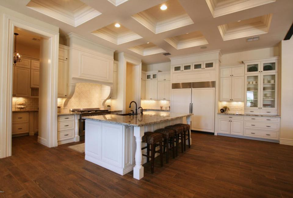 kitchen with a walk-through pantry, white cabinets & amazing shadow box ceiling