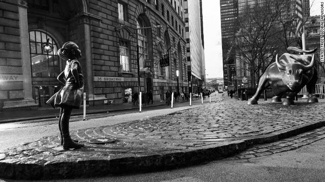 girl statue across the wall street bull