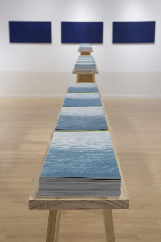 "Horizon Line, 2,000 screen prints, 20' x 7"" x 4', 2017"