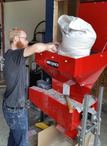 """Kevin crushing malted barley in our Rad Model 200roller mill in preparation for the """"mash"""""""