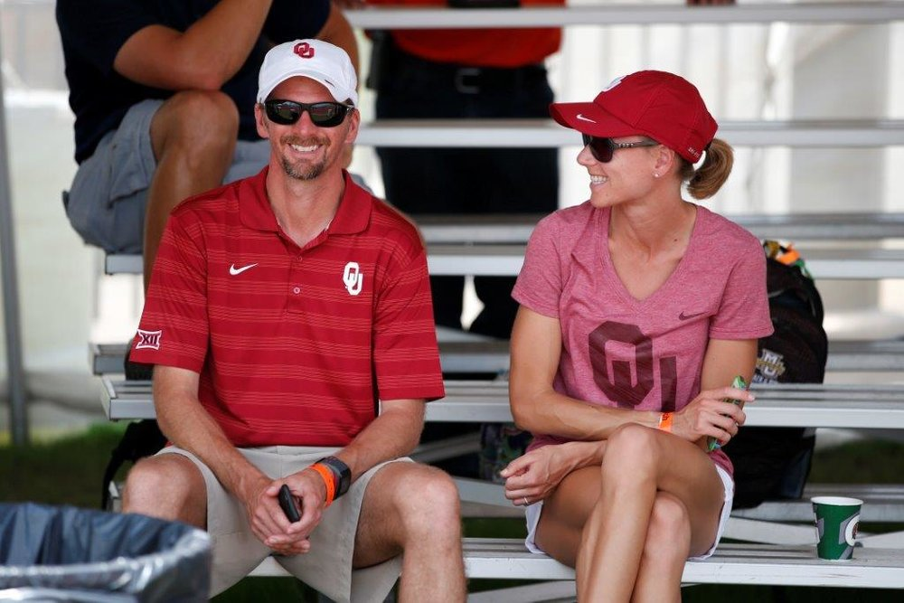 Jason and Ann coaching at OU, their last stop on the NCAA coaching circuit before coming home to Charlottesville, VA