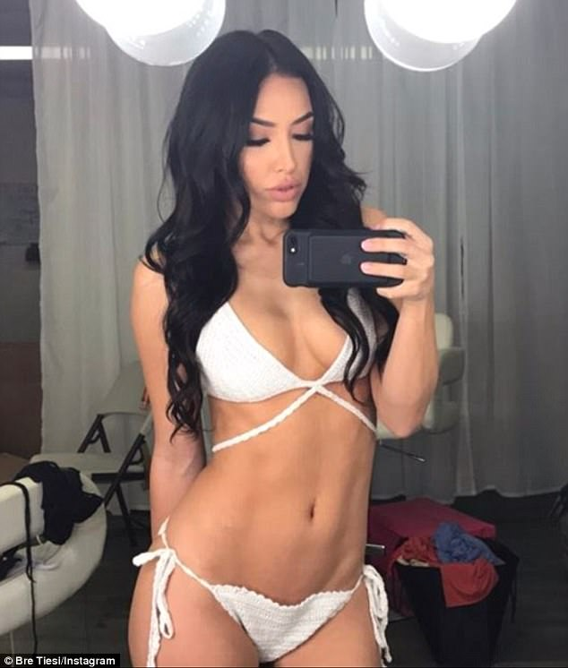 Wonder in white: Her body looked to be in incredible shape as she showed off looks from Los Angeles based clothing company Posh Shop