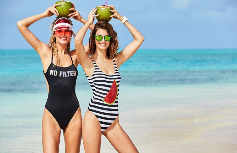 Posing on the beach, Toni Garrn and Ophelie Guillermand wear Calzedonia's one-piece swimsuits