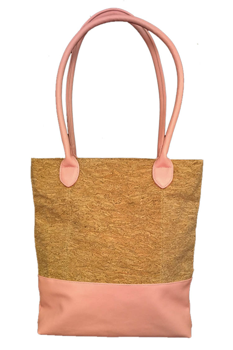 CALYPSO STUDIOS introduces a versatile, fully-lined beach-to-street tote bag combining leather and cork. Available in blush (pictured), blue and mint.
