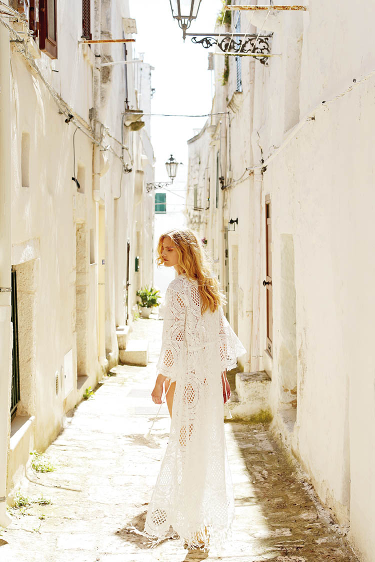 RAFFAELA D'ANGELO's long button-front kaftan is constructed entirely of cotton macraméd lace with fringed hem. Made in Italy.