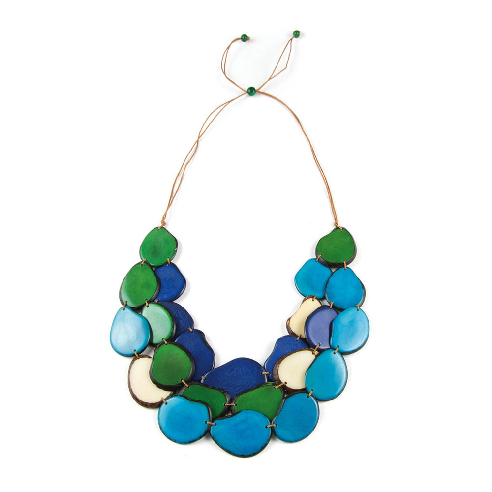 Presented in the brilliant hues of aqua, royal, emerald and white, a lightweight adjustable necklace by ORGANIC TAGUA is made from the sustainable, organic tagua nut found only in the rainforest of Ecuador.