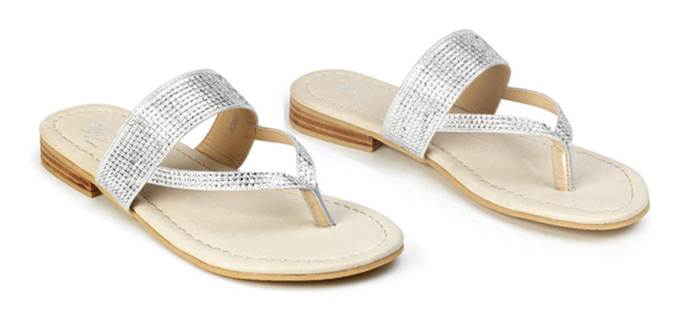 A genuine leather sandal with padded memory-foam base is adorned with shimmering crystals by SAVI RESORT WEAR.