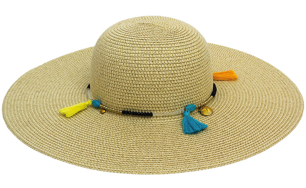 Fun colorful tassels, gold-toned charms and tiny beads encircle a beach-to-street straw hat from MAGID ACCESSORIES.