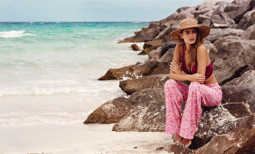 A cranberry print beach pant by HELEN JON is constructed of tactel/spandex blend. The roomy legs and fold-over waist design with tummy-toner effect is flattering for all body types.