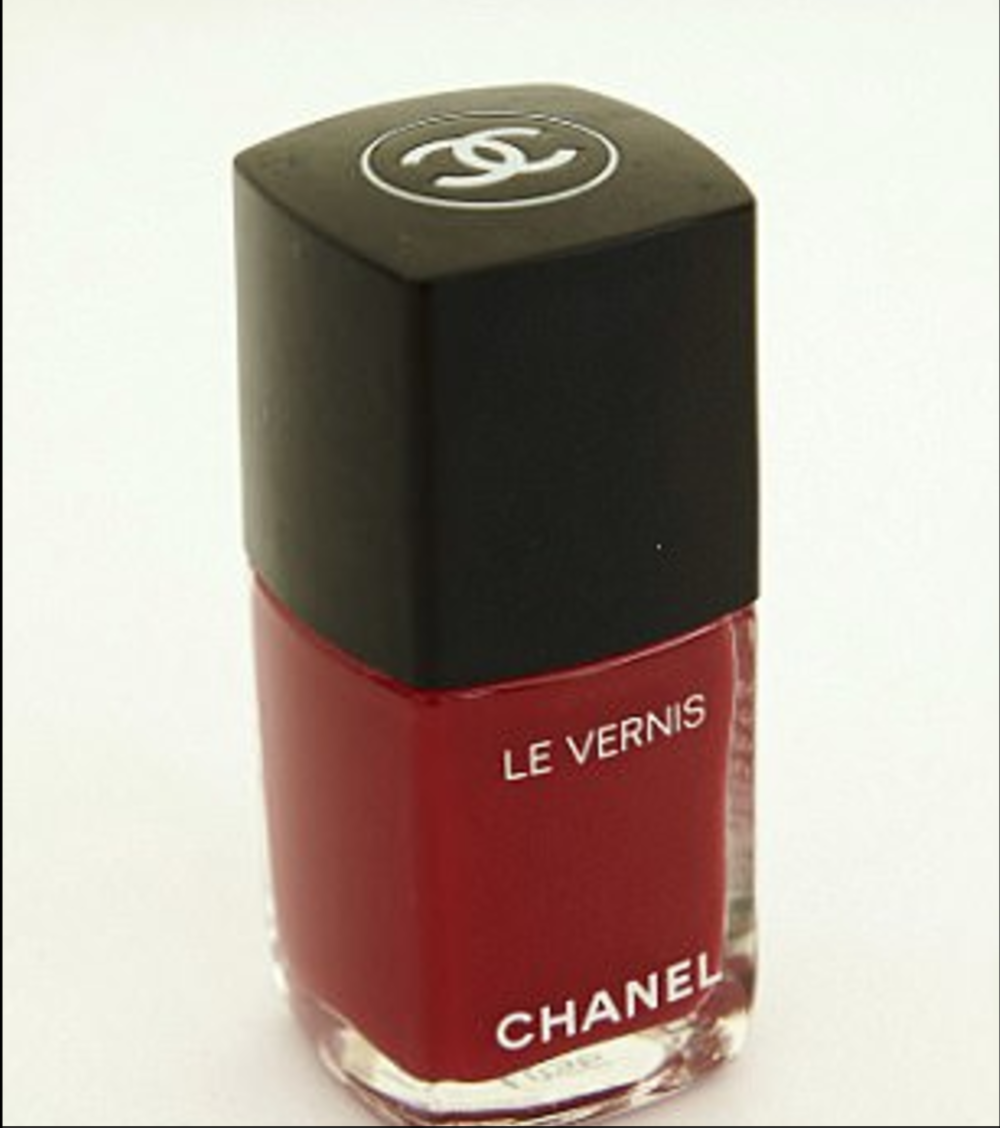 6 of 8 I am a beauty addict and love a red nail. Chanel Le Vernis in Shantung is perfect and always complements what I wear, which is mostly red, black and white. I've loved wearing black since I was a child.