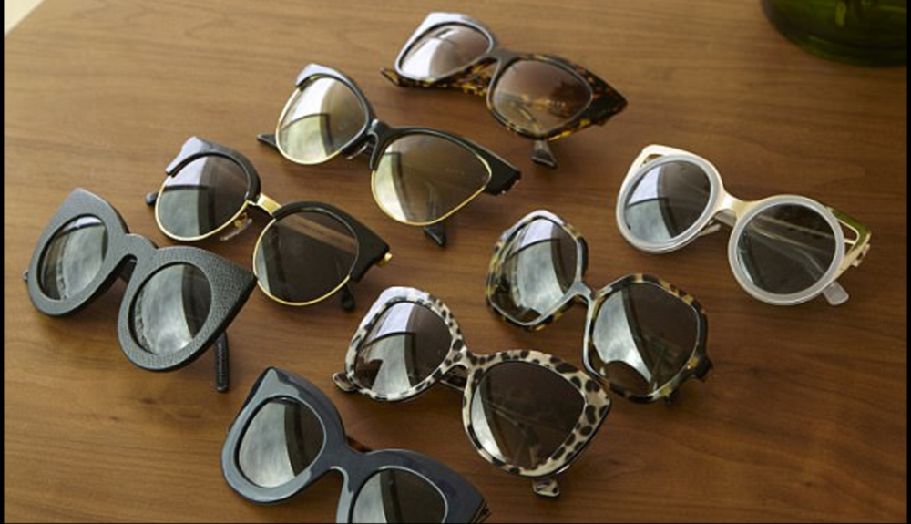 I have about 50 pairs of sunglasses – they are a true expression of how I'm feeling on any given day. If I'm happy, I'll go for an exuberant pair and if I'm sombre, I'll choose a more sedate option. My current favourites are this Prada pair [second in from right] and Valley Eyewear's leather-framed Wolves [far left], which look like cats' eyes.